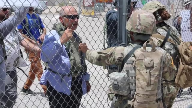 Soldiers with North Carolina National Guard deployed for Operation Hickory Sting conduct crowd control protest training at National Training Center...