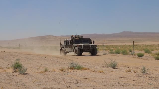 soldiers with north carolina national guard deployed for operation hickory sting conduct calibration at national training center fort irwin... - infanterie stock-videos und b-roll-filmmaterial