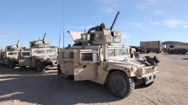 stockvideo's en b-roll-footage met soldiers with north carolina national guard deployed for operation hickory sting depart national training center fort irwin california to conduct... - humvee