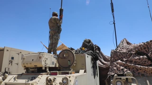 stockvideo's en b-roll-footage met soldiers with north carolina national guard deployed for operation hickory establish a tactical operation center at fort irwin california to conduct... - infanterie