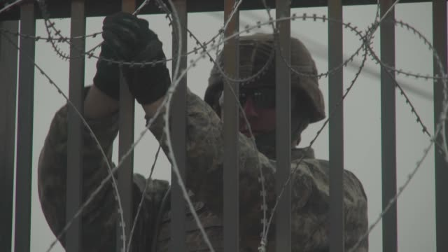 soldiers with the 889th engineering support company run concertina wire along the gateway international bridge in brownsville texas as part of the... - united states department of defense stock videos and b-roll footage