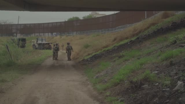soldiers with the 889th engineering support company run concertina wire along the gateway international bridge in brownsville texas as part of the... - united states department of defense stock videos & royalty-free footage