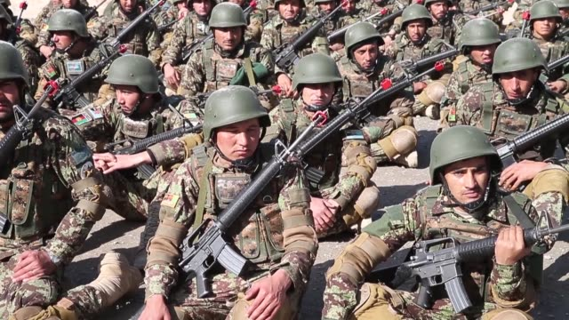 ts soldiers with the afghan national army participate in a graduation ceremony from basic training at the ana's combined fielding center on march 18... - afghan national army stock videos & royalty-free footage