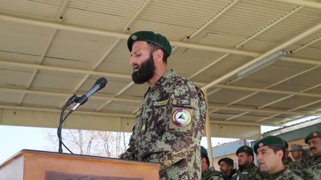 MS Soldiers with the Afghan National Army participate in a graduation ceremony from basic training at the ANA's Combined Fielding Center on March 18...