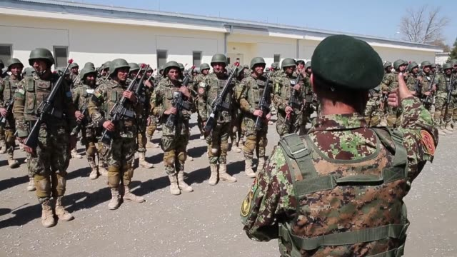 ls soldiers with the afghan national army participate in a graduation ceremony from basic training at the ana's combined fielding center on march 18... - afghan national army stock videos & royalty-free footage