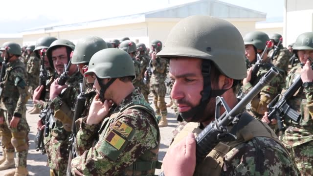 cu soldiers with the afghan national army participate in a graduation ceremony from basic training at the ana's combined fielding center on march 18... - afghan national army stock videos & royalty-free footage