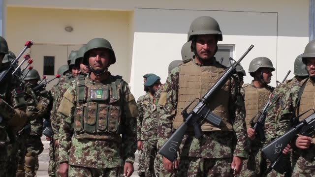 pan soldiers with the afghan national army participate in a graduation ceremony from basic training at the ana's combined fielding center on march 18... - afghan national army stock videos & royalty-free footage