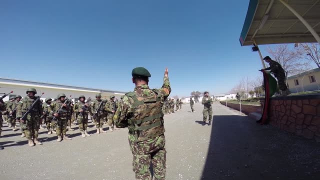 soldiers with the afghan national army participate in a graduation ceremony from basic training at the ana's combined fielding center on march 18,... - afghan national army stock videos & royalty-free footage