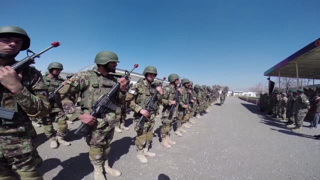 Soldiers with the Afghan National Army participate in a graduation ceremony from basic training at the ANA's Combined Fielding Center on March 18...
