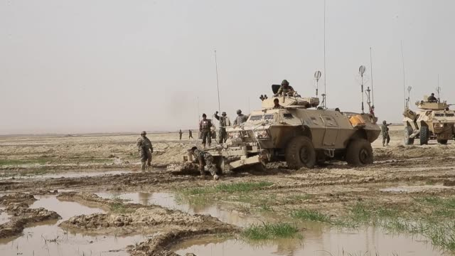 ls soldiers with the afghan national army recover a tactical vehicle after it becomes stuck in a muddy field while on patrol with soldiers from the... - afghan national army stock videos & royalty-free footage