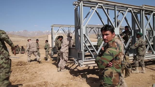 MS Soldiers with the Afghan National Army's National Engineer Brigade learn how to construct a MabeyJohnson portable prefabricated bridge with the...