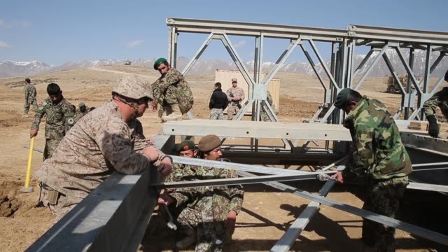 WS Soldiers with the Afghan National Army's National Engineer Brigade learn how to construct a MabeyJohnson portable prefabricated bridge with the...