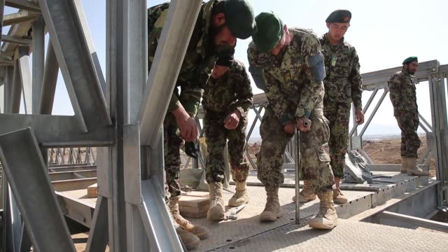 ls soldiers with the afghan national army's national engineer brigade learn how to construct a mabeyjohnson portable prefabricated bridge with the... - afghan national army stock videos & royalty-free footage
