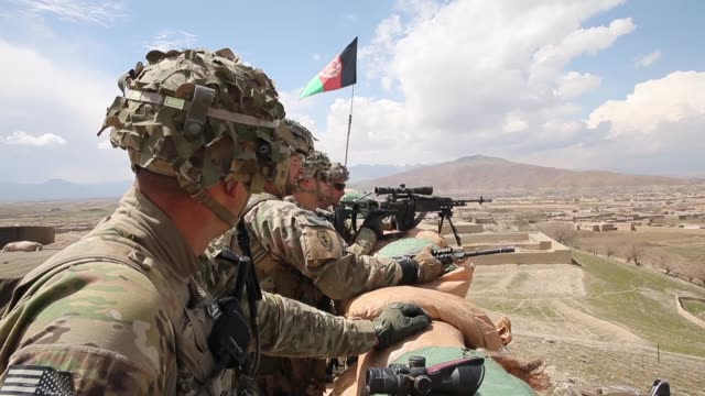 ms soldiers with the us army's 2nd battalion 87th infantry regiment 3rd brigade combat team 10th mountain keep watch from inside an afghan national... - 懐中時計点の映像素材/bロール