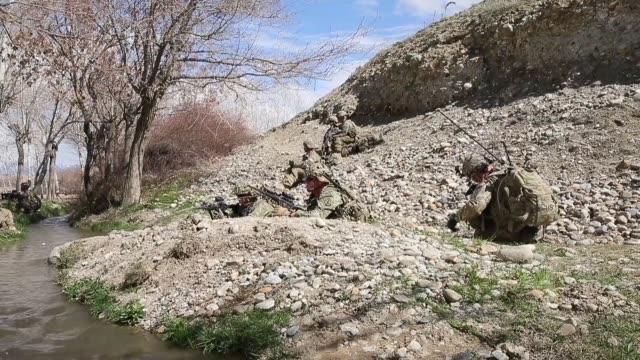 ls soldiers with the us army's 2nd battalion 87th infantry regiment 3rd brigade combat team 10th mountain keep watch during a patrol on march 29 2014... - 懐中時計点の映像素材/bロール
