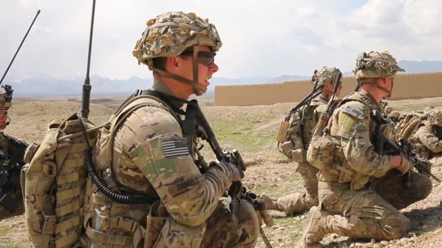 ms soldiers with the us army's 2nd battalion 87th infantry regiment 3rd brigade combat team 10th mountain keep watch during a patrol on march 29 2014... - 懐中時計点の映像素材/bロール