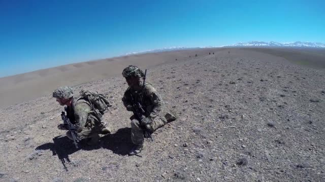 soldiers with the us army's 2nd battalion 87th infantry regiment 3rd brigade combat team 10th mountain division patrol outside forward operating base... - afghanistan stock videos & royalty-free footage