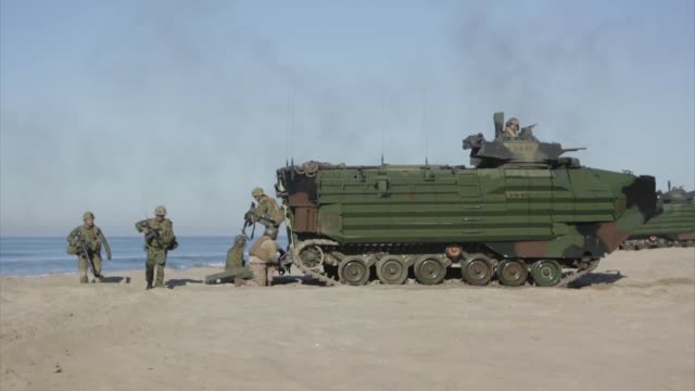 soldiers with the western army infantry regiment japan ground self defense force conduct an amphibious assault onto red beach and clear a simulated... - amphibious vehicle stock videos & royalty-free footage