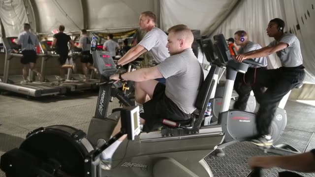 ls soldiers workout at one of the gyms on bagram airfield on march 13 2014 near bagram afghanistan located about 35 miles from kabul bagram airfield... - bagram air base stock videos & royalty-free footage