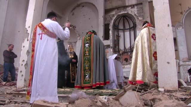 A solemn group of Christians held their first prayer service in years on Saturday in the ravaged church of St Mary in Syria's eastern Deir Ezzor city