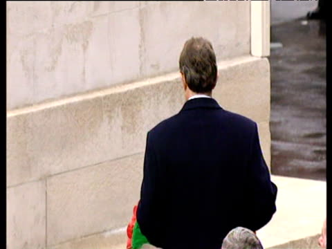 solemn looking tony blair prime minister carries wreath and lays it on cenotaph at remembrance day service 09 nov 03 - 花輪を捧げる点の映像素材/bロール