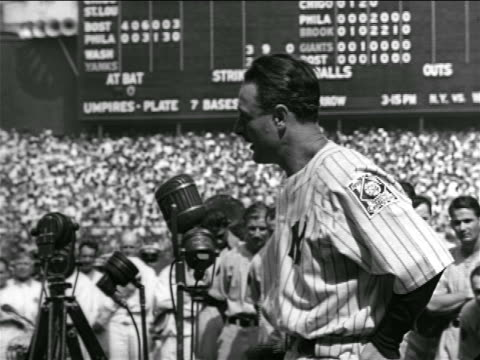 profile solemn lou gehrig making farewell speech in crowded stadium - lou gehrig stock videos & royalty-free footage