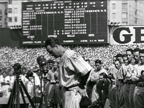 b/w 1939 solemn lou gehrig standing at microphone struggling to talk / farewell speech - lou gehrig stock videos & royalty-free footage