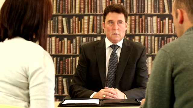solicitor / finanical advisor talking to couple - dolly - divorce stock videos and b-roll footage