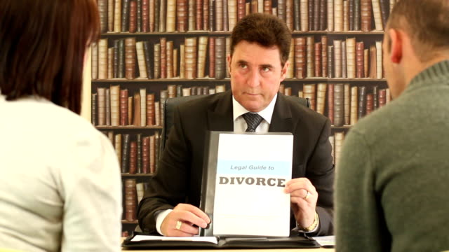Solicitor / Lawyer talks to couple about Divorce