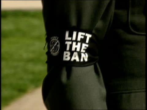 soliders in uniform wearing 'lift the ban' armband for gay rights in washington dc - 1993 stock-videos und b-roll-filmmaterial