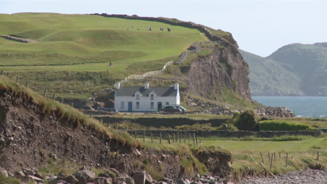 ws  solitary house with coastal golf course / waterville, county kerry, ireland - establishing shot stock videos & royalty-free footage