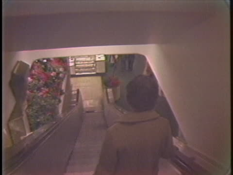 solitary woman takes the escalator in a virtually empty macy's department store. - department store stock videos & royalty-free footage