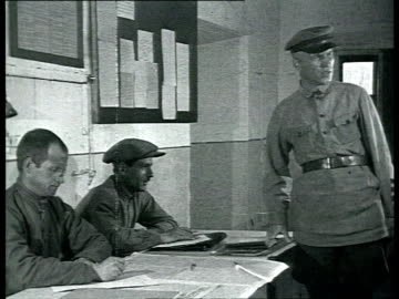 stockvideo's en b-roll-footage met solovki labor camp, prisoners come before camp committee / solovetsky island, russia - 1928
