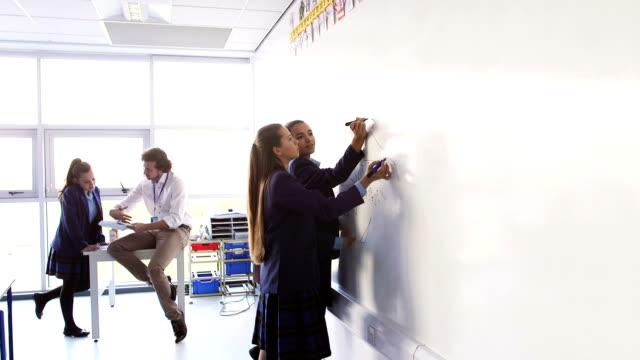 solving a mathemtatics problem - school uniform stock videos & royalty-free footage
