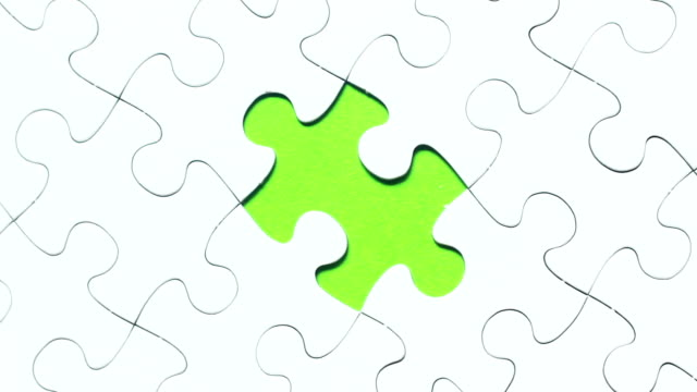solving a puzzle - jigsaw puzzle stock videos & royalty-free footage