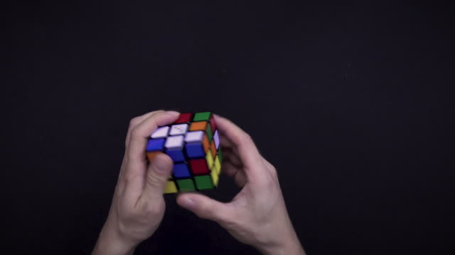 solving cube puzzle - sped up version - mathematics stock videos and b-roll footage