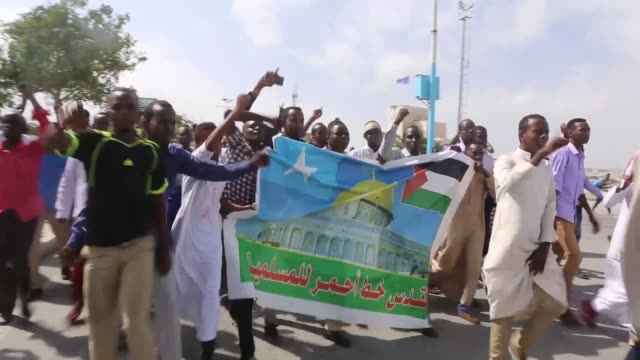 Somali demonstrators march during a protest against US President Donald Trump's recognition of Jerusalem as Israel's capital on December 08 2017 in...