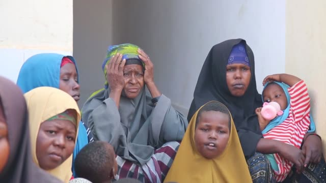 somali people who fled their homes in lower shabelle region due the attacks of al-shabab terrorist organization and floods, shelter at a school in... - somalia stock videos & royalty-free footage
