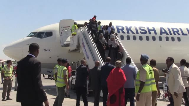 Somali refugees arrive in Mogadishu on Saturday after being held in Libya for years