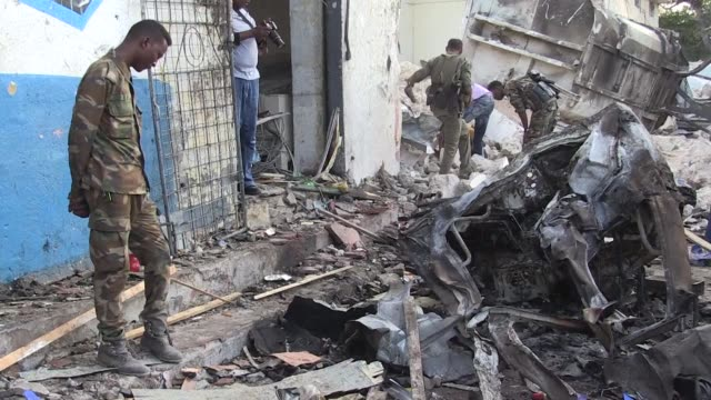 Somalia says its security forces killed two gunmen and captured three after coordinated car bomb blasts left at least 14 people dead just two weeks...