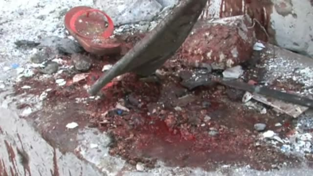 somalian security forces and health officials inspect the site where a car bomb detonated near banoda restaurant near the presidential complex... - ソマリア点の映像素材/bロール