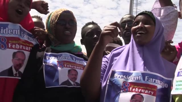 Somalis celebrate in the streets after former prime minister Mohamed Abdullahi Mohamed was elected president on Wednesday vowing to crack down on...
