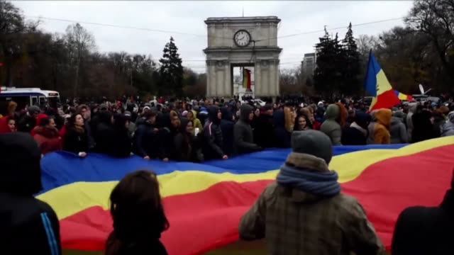 some 1000 people protest in central chisinau after pro russian candidate igor dodon emerged as the winner of moldovas hotly disputed presidential... - moldova stock videos and b-roll footage