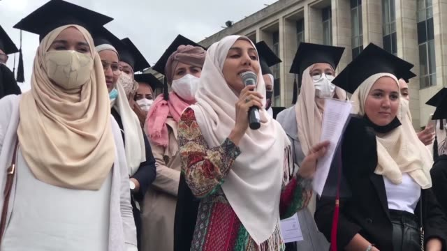 some 1000 people took the streets in the belgian capital on sunday to advocate for the right to wear headscarves at universities the... - headscarf stock videos & royalty-free footage