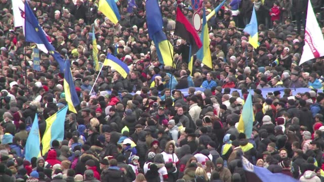 Some 100000 Ukrainians chanting Revolution swarmed a central Kiev square Sunday in a mass call for early elections meant to punish President Viktor...