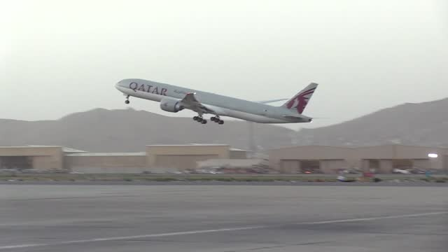 some 150 afghan dual nationals left afghanistan for the us on a qatar airways flight on thursday, sept. 9. the plane departed from kabul's hamid... - only young men stock videos & royalty-free footage