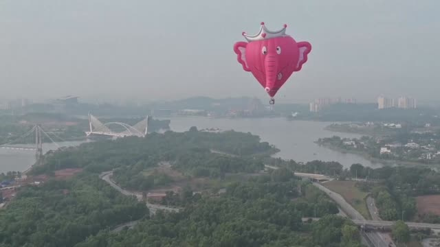 some 20 hot air balloons fill the sky over the malaysian city of putrajaya as a four day international balloon festival kicks off - putrajaya stock videos & royalty-free footage