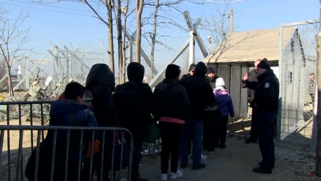 Some 2000 migrants begin crossing into Macedonia in freezing temperatures after the country conditionally reopened its border with Greece after...