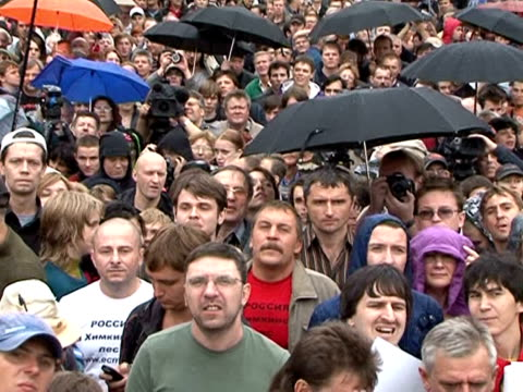 some 2000 people sunday crammed into a moscow square amid a heavy police presence for a banned rock concert to protest plans to build a motorway... - natural land state stock videos & royalty-free footage