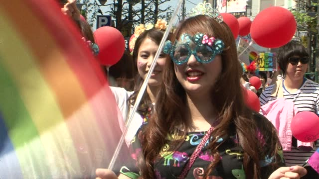 Some 3000 people march in a gay pride parade in Tokyo as calls grow for Japan to legalise same sex marriage after a lesbian couple held a symbolic...